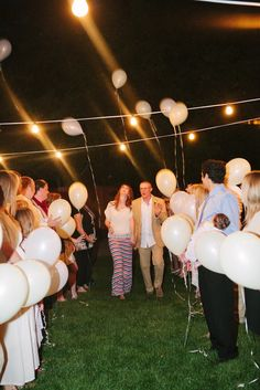 everyone gets a balloon and when the bride and groom go by you release it, it's magical.