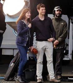All smiles! Dakota Johnson and Jamie Dornan giggled their way through re-shoots on the Vancouver International Airport set of Fifty Shades Of Grey on Tuesday