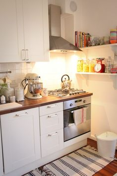 next incarnation of the kitchen.  white cabinets with a dark butcher block counter