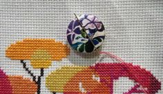 Never lose a needle again! This beautiful purple floral needle minder is made with wooden buttons and strong magnets! The back magnet has a Needle Minders, Magnets, Strong, Buttons, Purple, Floral, Beautiful, Florals, Flower