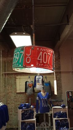 Light fixture from vintage Kansas license plates. www.facebook.com/thetealbutterfly