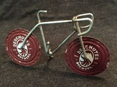 This bottle cap bicycle is cool. Handmade in the PNW.