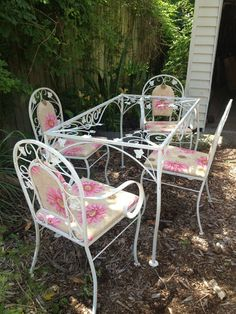 wrought iron patio set offered on eBay for $650.00 Chair arms don't appear to be Woodard.