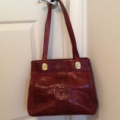 Host PickVintage Marino Orlandi handbag Authentic vintage Marino Orlandi handbag. Distressed brown genuine leather with gold M logo detail. 2 large compartments with inside zipper and back outside zipper. Gently used, no rips or stains. Made in Italy Marino Orlandi Bags