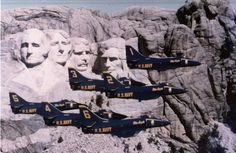 Blue Angels squadron in flight in front of Mount Rushmore, 1976