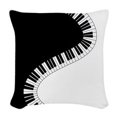 Piano Keyboard Woven Throw Pillow. A curving black and white piano keyboard divides black from white in this whimsical graphic design that is sure to delight the musician. See more here.. http://www.cafepress.com/dd/97974819?aid=113483648 #music