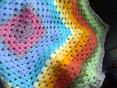 Crochet blanket using left over pieces of wool, and crocheting them into the colours of the rainbow