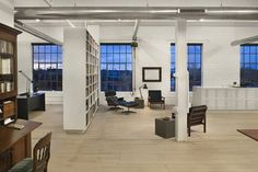 White Loft by in Philadelphia, 'smart' storage bookshelves/display cases/room dividers, exposed heating ducts, bleached maple floors, Remodelista Loft Studio, Studio Room, Dream Studio, Lofts, Style At Home, Loft Spaces, Living Spaces, Living Room, Decor Interior Design
