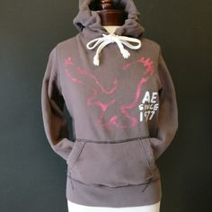REDUCED American Eagle super soft fitted hoodie American Eagle brown, super soft fitted hoodie with pink, eagle logo on front. Nice condition, barely worn.  68% cotton / 32% polyester American Eagle Outfitters Tops Sweatshirts & Hoodies