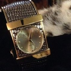 JOAN RIVERS Exotic Cuff Watch NEW - Never Warn. Blk/Gold Modern Exotic Cuff Watch. Includes jewelry pouch. Stainless Steel back. Joan Rivers Accessories Watches