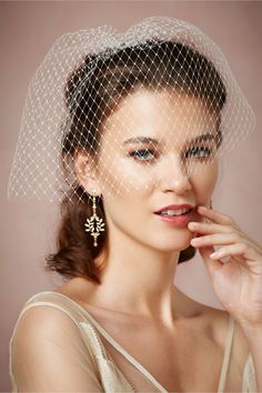Debra Moreland's Lady Luck Blusher veil ($140) is a chic option for the bride looking for a shorter veil option.