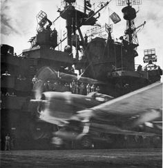 """Hellcat roars off the flight deck of """"the blue ghost"""" – The USS Lexington This photo was taken aboard the USS Lexington and was one of Capt. Steichen's own. He had a special feeling for takeoff shots, contrasting action with a still background."""