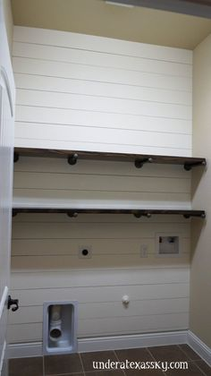 A shiplap accent wall worked perfectly in this laundry room makeover. A shiplap accent wall worked perfectly in this laundry room makeover. Industrial… A shiplap acce Laundry Room Remodel, Laundry Room Organization, Laundry Room Design, Laundry In Bathroom, Basement Laundry, Laundry Room Makeovers, Laundry Storage, Laundry Room Shelves, Washroom
