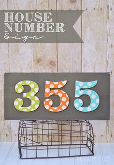 Use your Cricut Explore to cut vinyl polka dots for stenciling on this DIY House Number Sign. See the tutorial at www.thehappyscraps.com