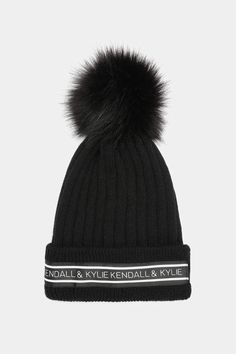 a96a0c17 The exclusive Kendall & Kylie collection presents the rib knitted winter  beanie. This hat features a large faux fur pompom and a ribbon with Kendall  & Kylie ...