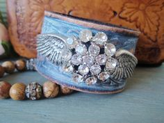 Angel wing Leather cuff, upcycled belt bracelet 'Sky Angel', sky blue, rhinestones, distressed, country rocker chic.