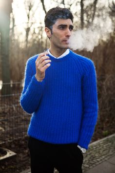 Knit Inspiration: Unknown. For the sophisticated man, a vibrant blue knitted sweater sets you apart from the crowd.