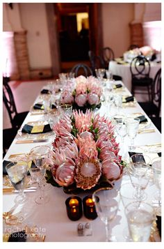 A bevy of king protea for a striking and unusual table escape. Floral design: Winston Flowers. Photo credit: Rachel Kate Photography.