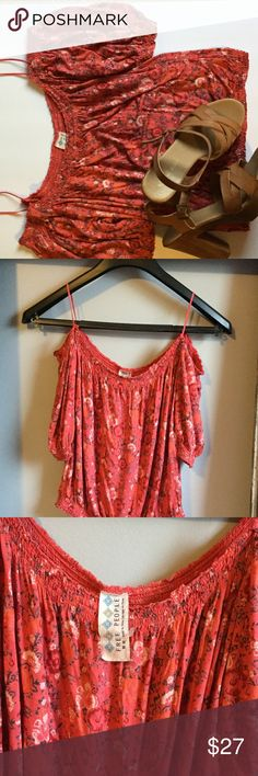 HOST PIC 6/15 Free People floral cold shoulder top Free People cold shoulder top. This top has a floral pattern. It is machine washable . This top is approx 19 inches from the top of shoulder to bottom hem. Free People Tops Blouses