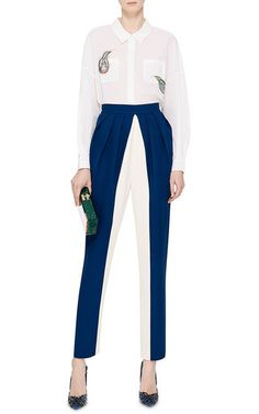 The emerging Russian designer puts forth refined ladylike looks with an irreverent edge. Keeping with her tailored signature, these blue and white silk pants from **Vika Gazinskaya** enthrall with subtle, avant-garde volume—thanks to a slight pintuck at the hips—lending a couture-like quality to a classic silhouette.