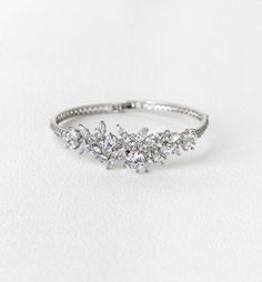 Product details - 14K White Gold plating over Sterling Silver base metal - Cubic Zirconia Crystals - Fold-over Clasp - Circumference- 7 in ITEM #B250-S