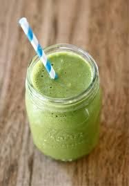 #green #smoothie with #spinach, #orange juice, #strawberries , #blueberries and frozen #banana