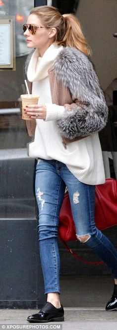 Bundled: The 29-year-old was spotted wearing a fur jacket layered over a knitted sweater w...