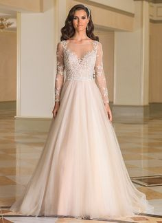 Justin Alexander Style This timeless ball gown look is achieved by the Sabrina neckline, pearl and crystal adorned bodice and illusion sleeves, plunging nude neckline and back, natural waist, and tulle skirt with a chapel length train. 2016 Wedding Dresses, Wedding Gowns, Bridesmaid Dresses, Wedding Bells, Lace Wedding, Tulle Ball Gown, Ball Gown Dresses, Long Sleeve Wedding, Wedding Dress Sleeves