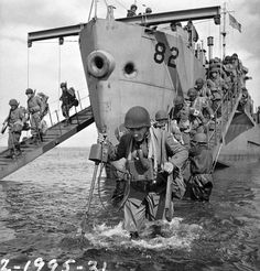 Infantrymen of the 13th Infantry Brigade Group disembarking from a landing craft during Operation COTTAGE, the invasion of Kiska, Aleutian Islands, 16 August 1943.