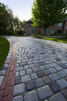 Driveway featuring Unilock Courtstone and Copthorne paver
