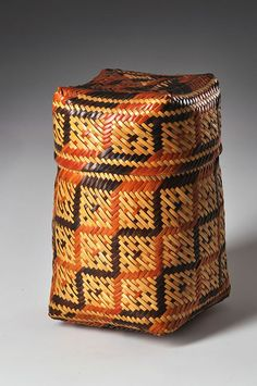 Lidded basket attributed to Clara Darden (Chitimacha), late 19th to early 20th century. Split river cane; twilled; double woven with a square block, cross, and dots design; natural dyes. The Caroline Boeing Poole Collection (Southwest Museum of the American Indian, 811.G.1082AB)