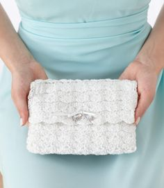 DIY Beautiful Bridah Clutch---The best and easiest crochet mini-purse for brides to have on their big days! #freecrochetpatterns #weddingideas
