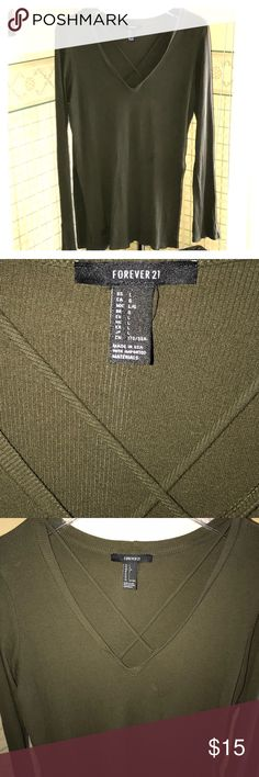 """⭐️FOREVER 21⭐️SEXY OLIVE CRISS-CROSS TUNIC/SIZE L ⭐️FOREVER 21⭐️ This long sleeve tunic is super sexy. I love the criss-cross design in the front. The ribbed design elongates & is very flattering to your figure. The sleeves have slits at the cuffs. And on the sides of this tunic are 7"""" slits that show a bit of skin, depending on if u wear alone or with a cute tank underneath. Either way this top is so gorgeous! Great with jeans or leggings, with a pair of knee high or over the knee boots…"""