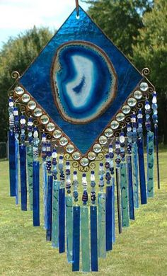 windchimes ---could use formerly popular stained glass or faux plastic artwork for the main piece