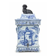 A blue and white cistern and cover, Kangxi period