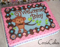 Monkey Baby Shower cake by Corrie76 on Cakecentral.com. I love the dots of pnk icing.  It reminds me of those great old blankets with nobs on them like my grandmother used to have.