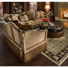 This Traditional Sectional Features Exposed Wood Accents, Nail Head Trim,  Shags And Tassels.