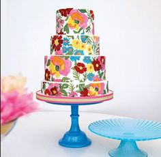 Eye-Popping Cakes  The cake style that dominates right now is clean and modern with just one amazing pop of embellishment such as a bow, monogram or flower. The other major look takes the opposite tack, using eye-popping color or all-over appliqués. And finally, a traditional idea has come around again: Brides are loving cakes that mimic wedding-dress details like lace.  Photo Credit: Cake Power