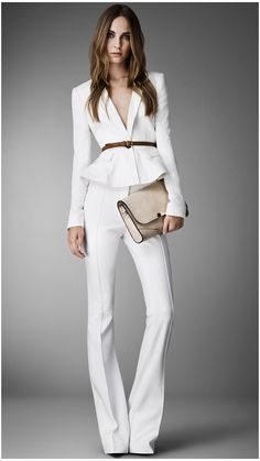 Tailored flared trousers in a soft stretch fabric Gently tapered leg opens into a wide flare below the knee Sharp centre crease, zip closure Trousers 395.00 USD