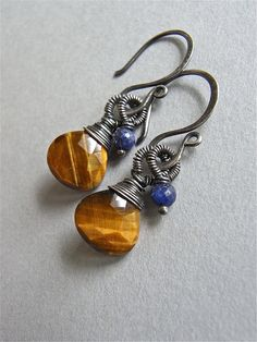 The Bengal earrings - petite and lightweight, these feature earthy tiger eye heart briolettes, and luxe sapphire rondelles.  Carefully wirewrapped with fine sterling silver wire then oxidised and selectively polished.