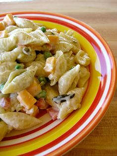 1 pound small pasta shells, cooked and drained 6 ounces medium or sharp cheddar cheese, cut in small cubes 2 cups baby peas, fresh or frozen 1 medium red pepper, chopped 1/2 medium onion, chopped 1/3 cup sweet pickle relish 1/2 cup mayonnaise 3/4 cup (6 ounces) plain yogurt 1/4 cup chopped pimientos Salt and Pepper to taste Mix all ingredients. Refrigerate for 1 hour.