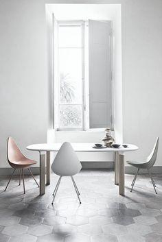Hex floor tiles, fancy chairs.