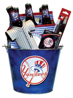 Yankee Beer Gift Basket Item Number: 2010101294Take me out to the ballgame. Get the tailgate party started with this metal Yankee bucket filled with a six pack of Brooklyn beer, a Yankee bottle hugger, Yankee playing cards and a Yankee toothbrush.