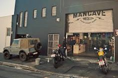 Cape Town motorcycle shop: The Woodstock Man Cave. South Africa is home to some of the world's most spectacular motorcycle roads. So we've picked out four of the best moto-friendly shops in Cape Town. Motorcycle Workshop, Motorcycle Shop, Motorcycle Garage, Garage Loft, Garage Shop, Dream Garage, Car Garage, Man Cave Diy, Man Cave Home Bar
