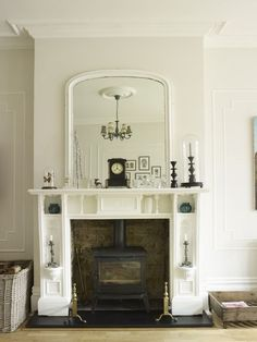 There wasn't really a design plan to this room, more of a slap-dash, happy accident kind of situation. I worked with what was there (which was not much bar the mouldings on the walls, the high skirting boards and a very dark fire place), kept the walls quite light (Farrow & Ball Strong White) and painted the fire place in Farrow & Ball's All White, added a big mirror above it to maximise light in that room.