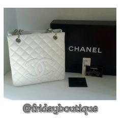 """Chanel Petit Shopping Handbag - White - New in Box Made in France not in Italy as are the later models. Get noticed with the perfect white color for year round. (It is not bright white)  Double handle straps have 9 1/2"""" drop, silvertone hardware,  aprox measurements 9 3/4 wide, 9 1/2 tall, 3 1/4 deep.  Inside flap pocket, zip pocket, and D ring. New in dust bag and box. Has been well stored so you can still smell the new leather.  Purchased at Chanel Boutique inside Neiman Marcus Houston in…"""