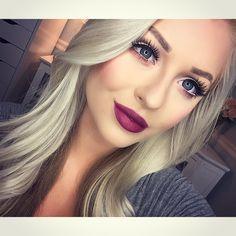A dark pink lipstick with a neutral eyeshadow