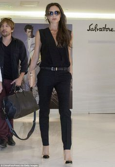 Strike a pose: The all black outfit showed off Victoria's slim build and effortless style