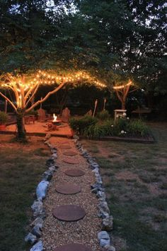 Backyard space with string lights, pavers and fire pit.. This look would be easy to replicate in anyone's backyard!!