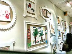 art display wall with corkboard frames art galleri, frame, display wall, childrens artwork display, display artwork, art displays, kid, galleri hallway, art walls